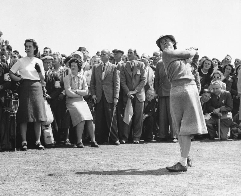 Louise Suggs of Atlanta, Ga., member of the U.S. Curtis Cup Women's golf team, drives at the first tee during the cup matches as Birkdale, England, May 21, 1948. The U.S. team defeated the British golfers, 6 1/2 to 2 1/2.