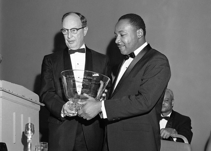 Dr. Martin Luther King Jr., right, winner of the 1964 Nobel Peace Prize, receives a glass bowl inscribed to him as a ''citizen of Atlanta, with respect and admiration,'' from Rabbi Jacob Rothschild of the Temple Synagogue in Atlanta on Jan. 27, 1965.
