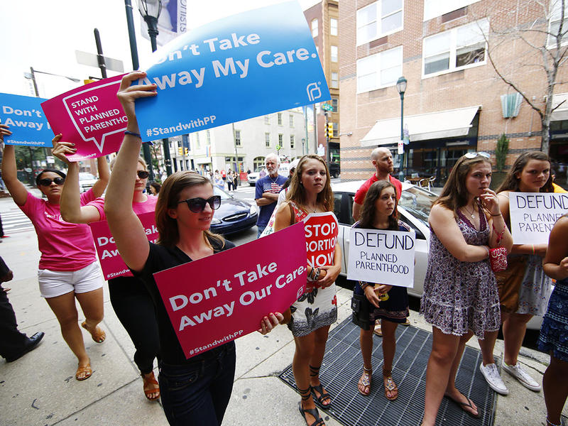Opponents and supporters of Planned Parenthood demonstrate Tuesday, July 28, 2015, in Philadelphia. Anti-abortion activists are calling for an end to government funding for the nonprofit reproductive services organization.