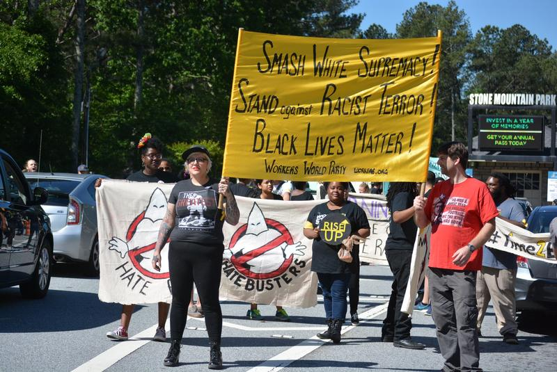 Counter-protestors block traffic at the entrance of Stone Mountain Park.