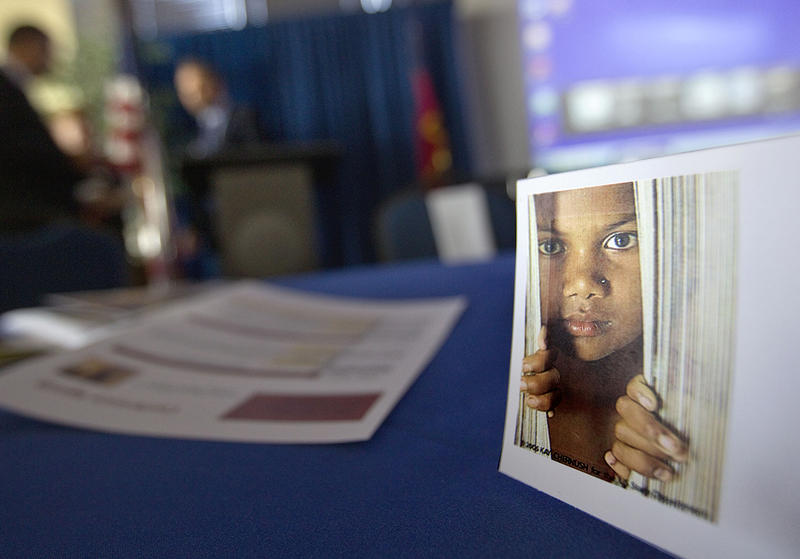 A placard of a child sits on a table during a conference on human sex trafficking  in Atlanta.