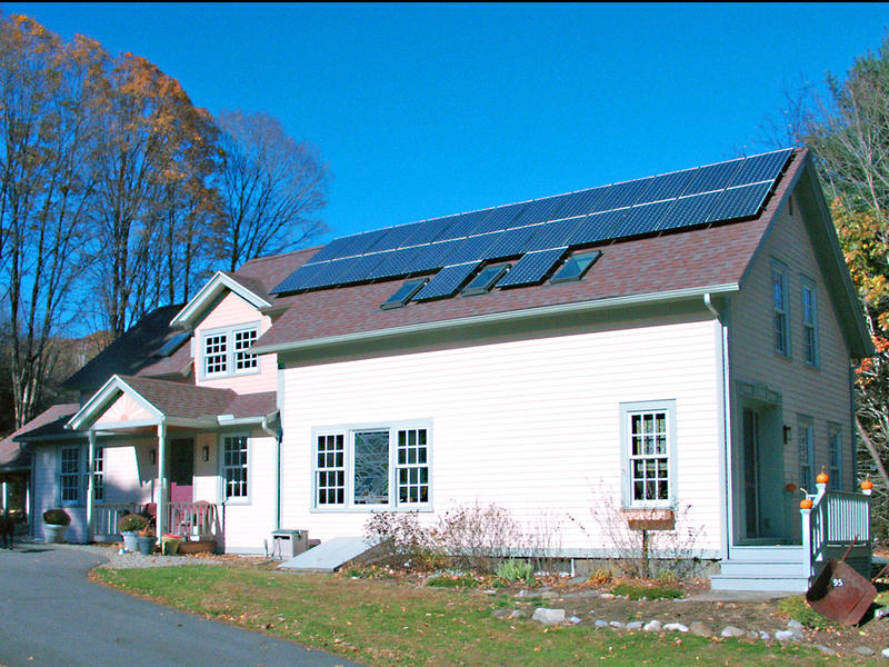 26 Sanyo PV modules sitting on the roof of a family home in Massachusetts produce a total of 5KW of solar electric energy. This set up is projected to produce roughly 100% of the household's electricity.