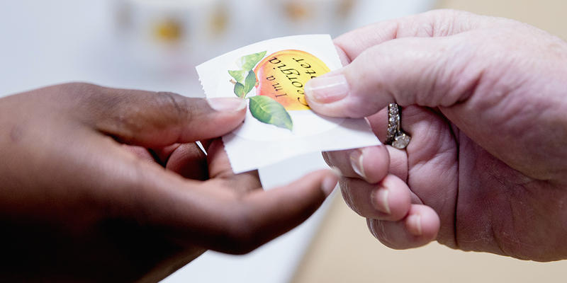 "A voter takes a ""I'm a Georgia Voter"" sticker after voting during Georgia's primary election at the polling station at South Lowndes Recreation Complex in Lake Park, Ga., Tuesday, March 1, 2016."