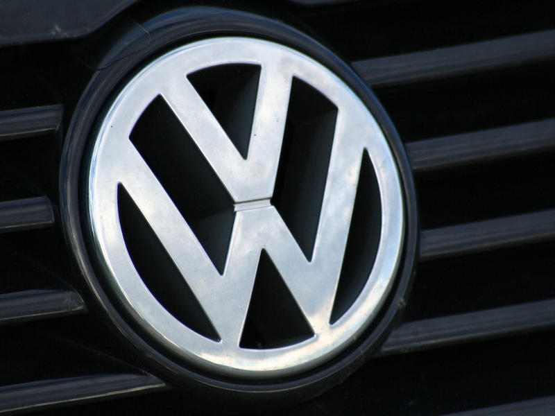 The Volkswagen logo on a VW car