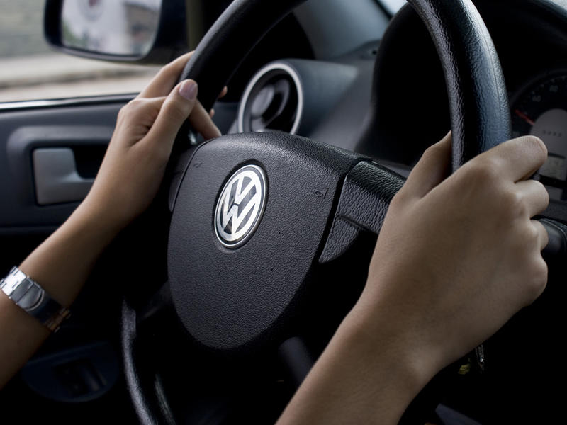 A portrait of a person at the wheel of a Volkswagen vehicle