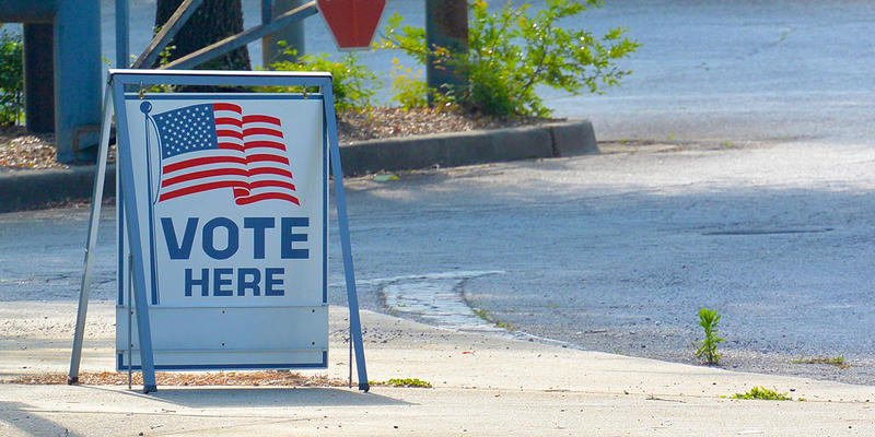 A 'vote here' sign near Smitha Middle School in the city of Marietta. The city voted July 12 to impose term limits of three consecutive four-year terms on council members and the position of mayor.