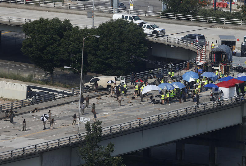 Actors and extras work during the filming of the Walking Dead, Tuesday, July 8, 2014, in Atlanta.