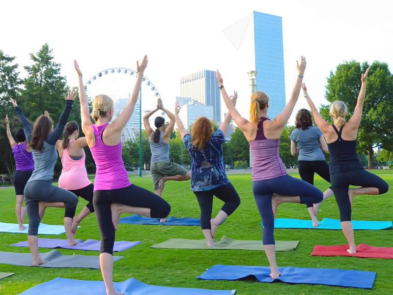 Women participate in yoga in downtown Atlanta, Ga.