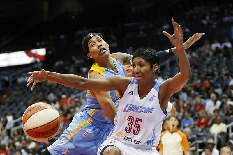 Atlanta Dream guard/forward Angel McCoughtry (35) and Chicago Sky forward Tamera Young (1) battle for a the ball  in the first half of Game 3 of the WNBA basketball Eastern Conference semifinals, Tuesday, Aug. 26, 2014, in Atlanta.