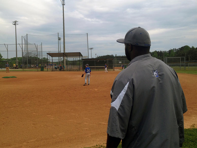 Atlanta area youth travel baseball coach Kenny James works on defensive plays with his team of 10-year-olds.