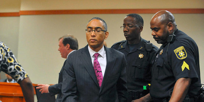 Embattled DeKalb County CEO Burrell Ellis is led out of the courtroom after he was sentenced to 5 years to serve 18 months in prison Wednesday July 8, 2015.