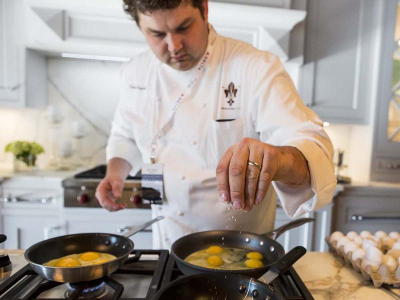 A chef prepares eggs at the Food and Wine Festival