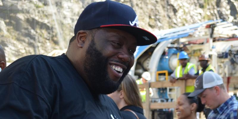 Rapper Michael Render, aka 'Killer Mike,' talks to reporters inside Bellwood Quarry where a big drill named in his honor will dig a five-mile tunnel to the Chattahoochee River.