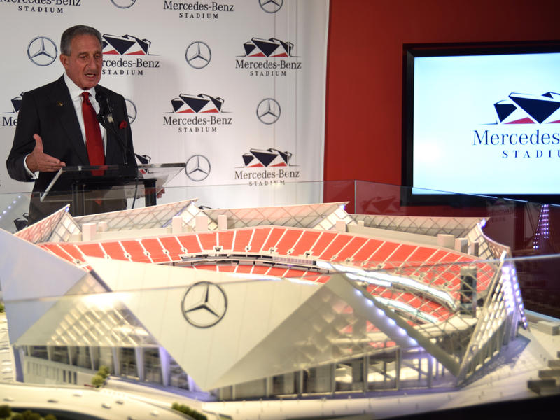 Atlanta Falcons owner Arthur Blank speaks in front of a model of the new Mercedes Benz Stadium