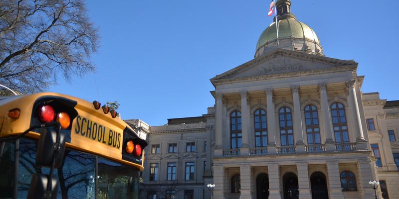A school bus in front of the Georgia Capitol