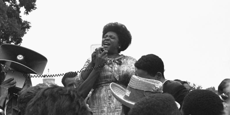 Mrs. Fannie Lou Hamer of Ruleville, MS, speaks to Mississippi Freedom Democratic Party sympathizers outside the Capitol in Washington, September 17, 1965, after the House of Representatives rejected a challenger to the 1964 election of five Mississippi re