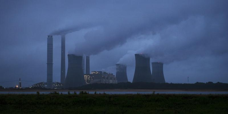 In this Sunday, June 1, 2014, file photo, the coal-fired Plant Scherer is photographed in Juliette, Ga.