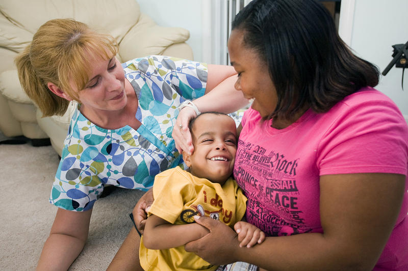 J. Tyler Raphael Sheets (center) with his adoptive mother, Monica Sheets (right) and Bobbi Jo Lorah, RN, his private-duty nurse who provides care for chronically ill children at home or at school.