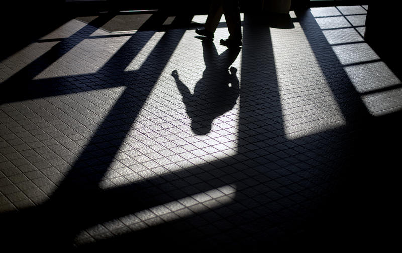 In this Friday, Dec. 7, 2012 photo, the shadow of a Georgia Department of Juvenile Justice correctional officer is cast as he leaves a training facility.