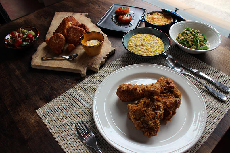 Chef Kevin Gillespie's menu offerings of fried chicken, lemon-glazed sweet potatoes, cucumber chow chow, local lady peas and snap peas in lemon dill butter, fatback fried corn, mid-century mac and the Gillespie Family iron-skillet cornbread.