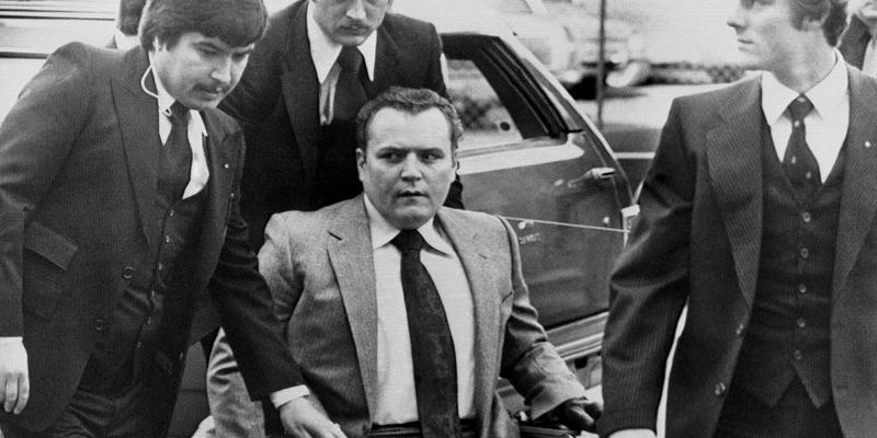 Hustler magazine publisher Larry Flynt is surrounded by heavy security as he arrives at the Fulton County Courthouse in Atlanta, March 19, 1979 for the start of his trial on obscenity charges.
