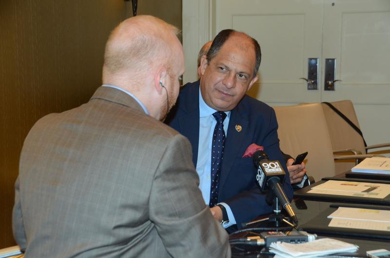 President Luis Guillermo Solís, the President of Costa Rica, visits with Jim Burress