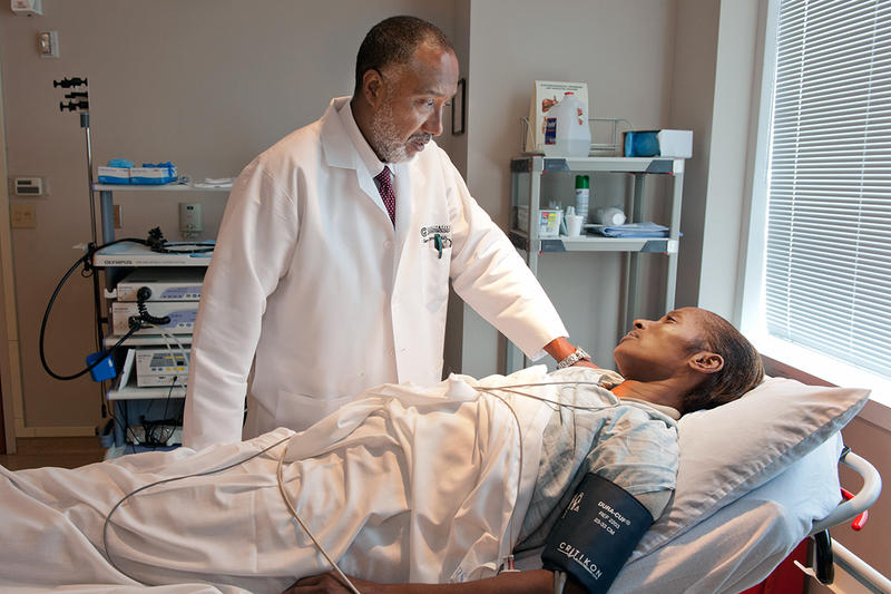 Dr. Gary C. Richter, M.D. talks with patient about a procedure in his office in Atlanta, Ga.