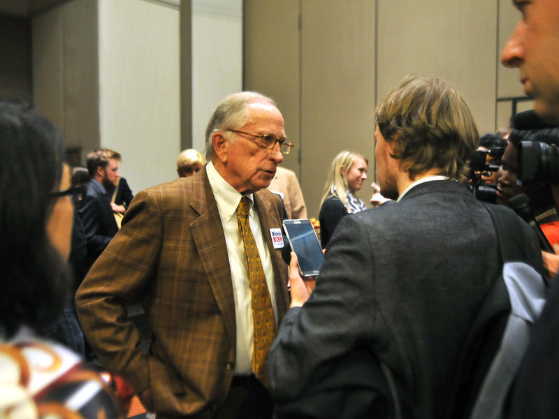 Sam Nunn speaks to a reporter at the Michelle Nunn 2014 election night party in Atlanta