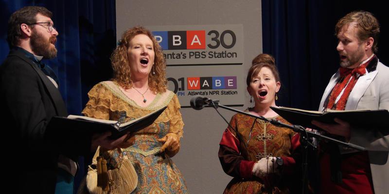 Like the Dickens Carolers (l-r) William Scott Mize, Kim Baran, Nan Nowell, and David Craven  perform at PBA studios Dec 14, 2015