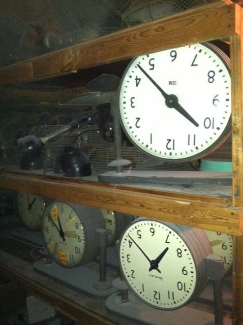Dozens of old clocks sit, filed away on shelves in the old Auto Center
