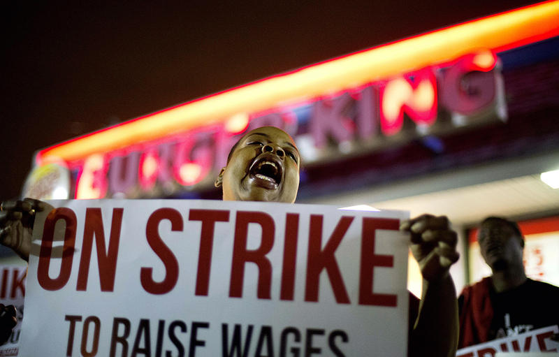 Fast food worker Qiana Shields chants during a demonstration outside a Burger King restaurant calling for the federal minimum wage to be raised to $15, Wednesday, April 15, 2015, in College Park, Ga.
