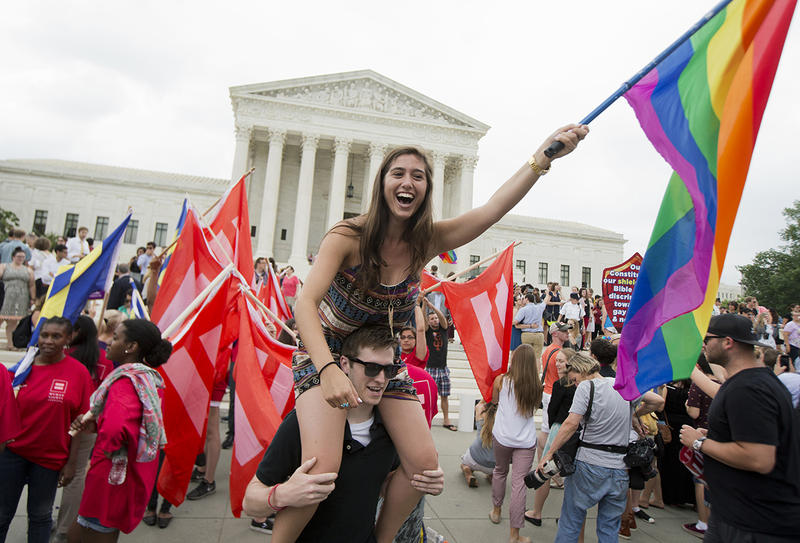 Sasha Altschuler of San Diego, Calif., joins the celebrations outside the Supreme Court in Washington, Friday, June 26, 2015 after the court declared that same-sex couples have a right to marry anywhere in the US.