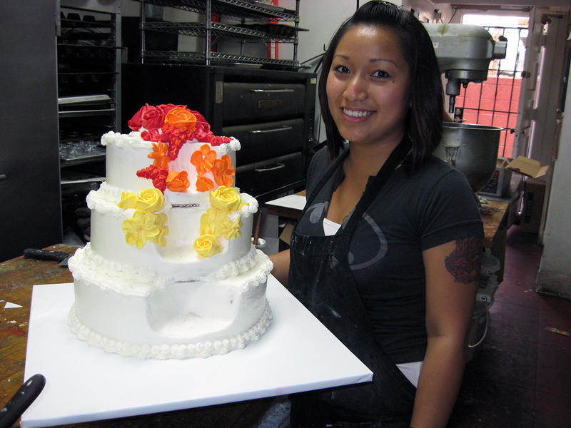 Rujira Roongruang prepares wedding cake for Robin Tyler and Diane Olson's wedding.