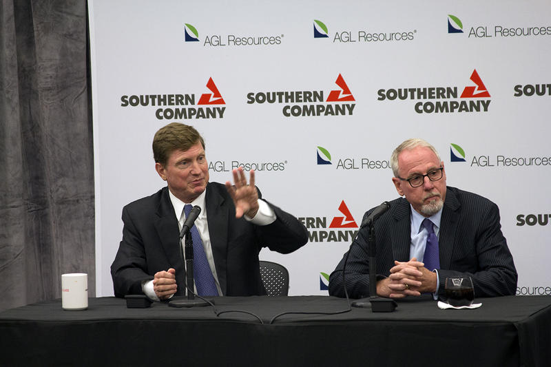 Southern Company Chairman, President and CEO, Thomas A. Fanning, left, sits next to John W. Somerhalder, II, AGL's Resources Chairman and CEO at the Southern Company and AGL merger press conference.