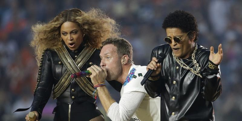 Beyoncé, Coldplay singer Chris Martin and Bruno Mars perform during halftime of the NFL Super Bowl 50 football game Sunday, Feb. 7, 2016, in Santa Clara, Calif.
