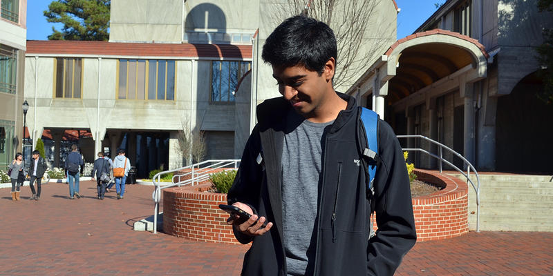 Emory student Naman Gupta using the Yik Yak app on Emory University's campus in Atlanta. Students protested hate speech on the app and called on the University to block the app on its campus.