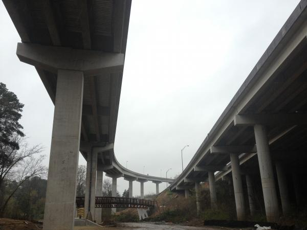 WABE was given a tour of the almost-completed flyover ramps this past weekend. The pedestrian bridge crosses Peachtree Creek as part of a trail system under development.