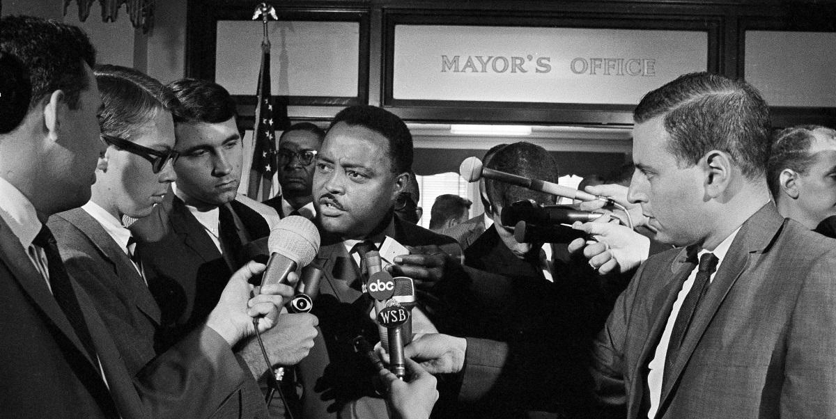 Hosea Williams, an aide to civil rights leader Martin Luther King Jr., speaks to newsmen, Sept. 12, 1966, after he and other civil rights leaders met with ...