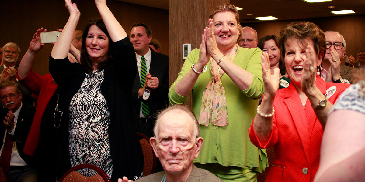 Karen Handel's supporters cheer the election results Tuesday night