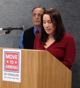 Emily Bishop, at microphone, organizer with New Yorkers Against Fracking; behind her is Michael Messina-Yauchzy, co-chair of Syracuse/CNY Move to Amend.