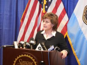 mayor stephanie miner at a podium