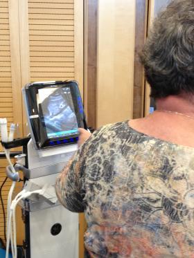 Nurse practitioner Carol Lee demonstrates a portable ultrasound machine to EMS professionals Monday at Onondaga Community College.
