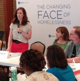 The Wilson Foundation's Megan Bell addresses leaders of the various agencies that serve Syracuse's homeless.