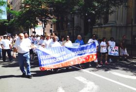 Marchers head down Montgomery Street to recognize 24th anniv of Americans with Disabilities Act.