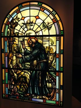 A bright religious stain glassed display greets visitors.