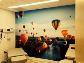 A patient exam room brings these hot air balloons up close.