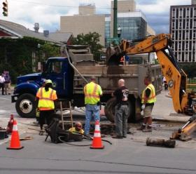 Syracuse Water Dept. workers repair a water main break at the intersection of E. Jefferson and Montgomery Streets that closed the Civic Center.