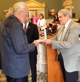 Fellow Vietnam Veteran and former Onondaga County GOP Chairman John DeSpirito III presents Daniel Hunnicutt with his lost Purple Heart Medal.
