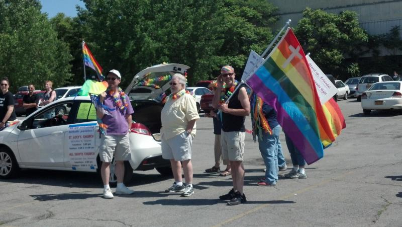 LGBTQ activists representing All Saints Parish wait in a parking lot near Destiny USA for the CNY Pride Parade to start on Saturday, June 15, 2013.