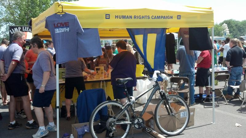 Visitors at the CNY Pride Festival stop by the Human Rights Campaign Booth on Saturday, June 15, 2013.